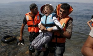 A Syrian refugee girl from Kobani is rescued in August from a boat stopping at Lesbos, Greece.