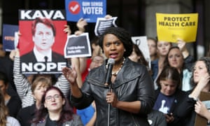 Ayanna Pressley speaks at a rally in Boston ahead of an appearance by Jeff Flake on 1 October.