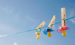 Three soothers pegged on to a washing line