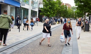 People wearing masks while shopping in the city centre in Preston