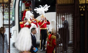 Members of the Household Cavalry arrive at the Sovereign's entrance, ahead of the state opening of parliament.