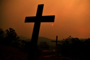 The sun is shrouded by smoke rising from a bushfire on Gospers Mountain, Australia