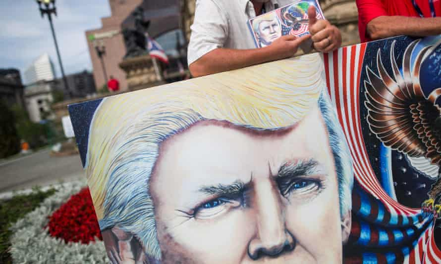 Trump supporter with painting of the president before the start of the Republican National Convention in Cleveland, Ohio