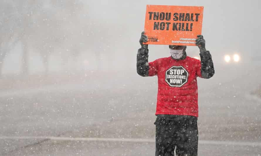 An activist in opposition to the death penalty protests outside the US penitentiary in Terre Haute.