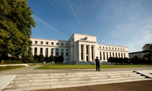 A police officer keeps watch in front of the U.S. Federal Reserve in Washington.