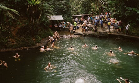 Passengers take a dip in a natural pool on Fiji