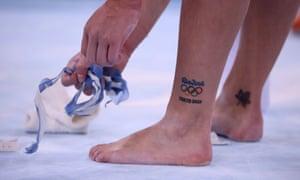 A Canadian gymnast shows off their tattoos.