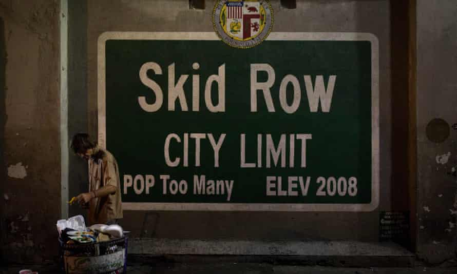 skid row sign says 'population: too many'