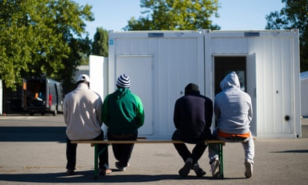 Men wait to be registered in Berlin, which received around 69,000 asylum seekers in the last two years.