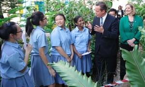 Britain's former prime minister, David Cameron, and his then education minister Amber Rudd talk to secondary school students in Singapore in 2015.