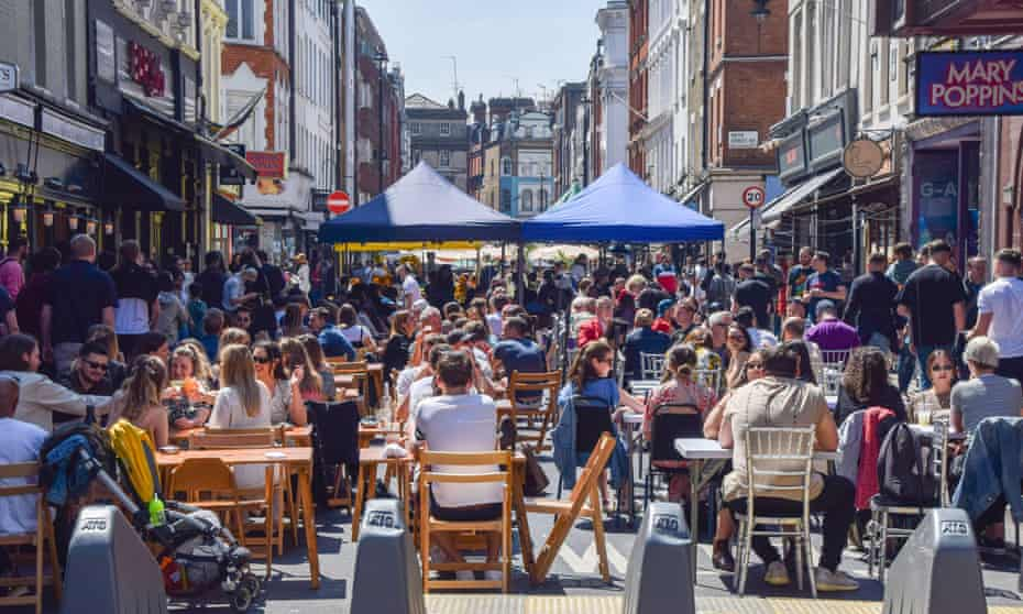 Busy restaurants and cafes in Old Compton Street, Soho, London in May 2021, after lockdown restrictions were eased.