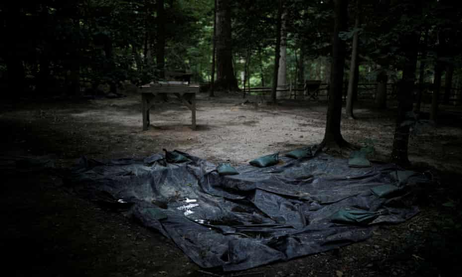 Plastic covers in an area believed to contain the remains of enslaved people at Mount Vernon, home of George Washington, in Fairfax county, Virginia.
