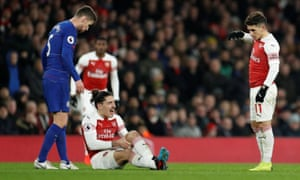 Arsenal's Hector Bellerin is in a bit of pain after his left knee gave way whilst he was chasing the ball.