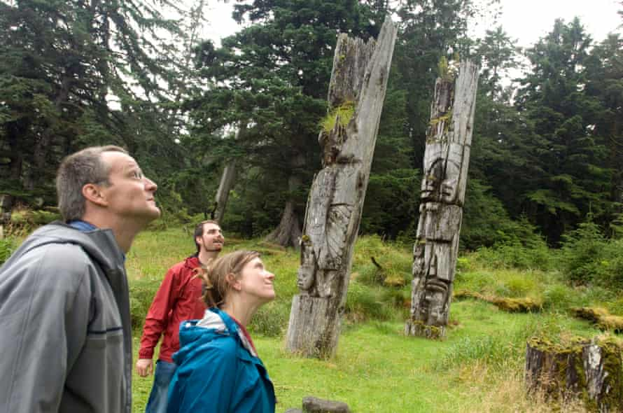 Haida totem poles, still in their original location and being allowed to decay, true to Haida belief.