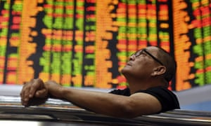 A man looks at stock market prices in Malaysia
