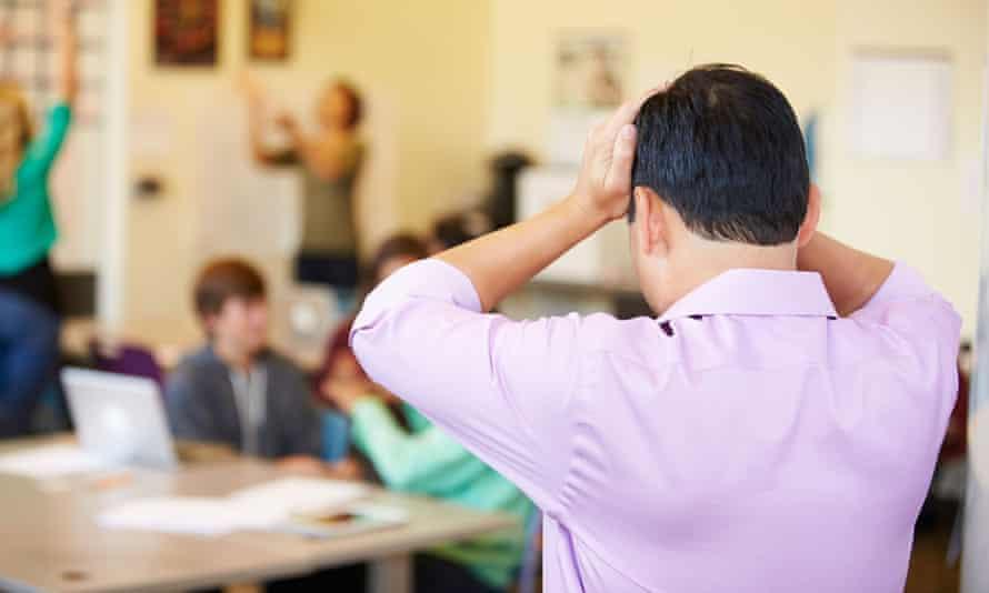 A stressed teacher in a classroom