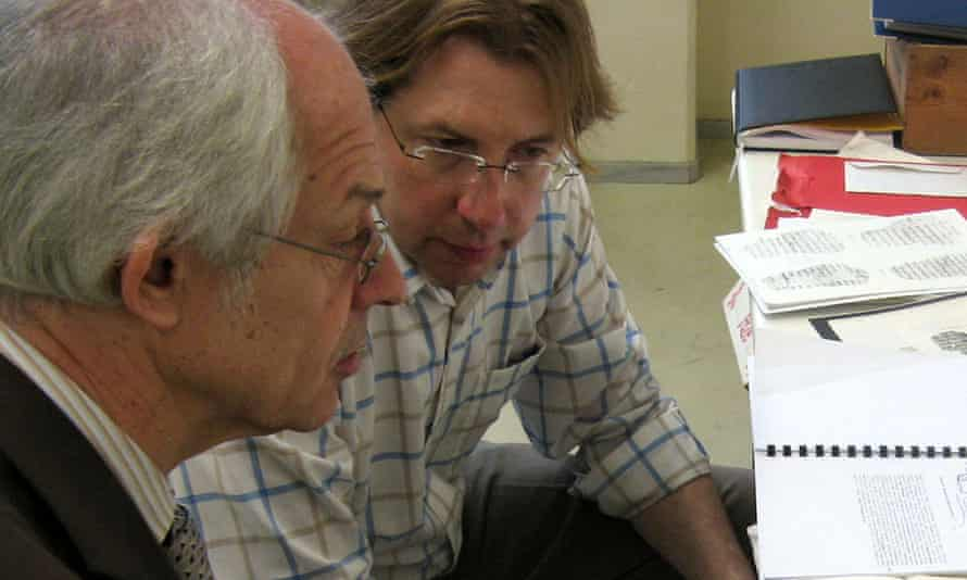 Dr Dirk Obbink and Apostolos Pierris examine facsimile images of a 2,400-year old scroll in Thessaloniki, Greece.
