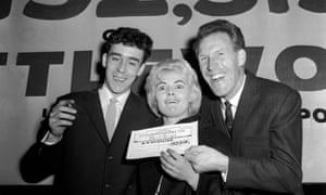 Bruce Forsyth presents a cheque to a pools winner in 1961