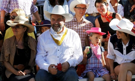 Federal NDP Leader Mulcair and his wife Catherine enjoy the Calgary Stampede parade on 3 July 2015.