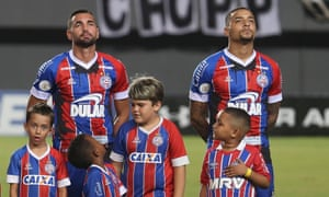 Bahia players wear their oil stained shirts before their league game against Ceara.