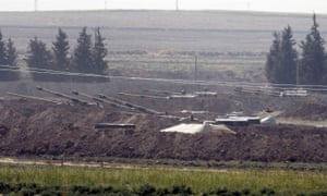 Turkish forces artillery pieces are seen on their new positions near the border with Syria in Sanliurfa province.