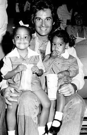 Robert Ellis Silberstein aka Bob Ellis attends a movie with daughters (L) Rhonda and Tracee in 1975 in Los Angeles, California