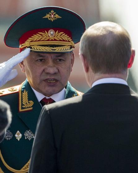 Sergei Shoigu, Russia's defence minister, salutes president Vladimir Putin.