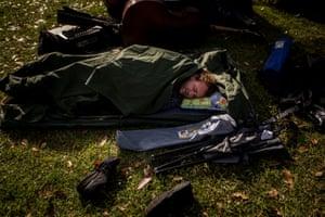 A musician from Tall Stories sleeps