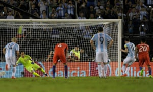 Lionel Messi sends Claudio Bravo the wrong way to score a penalty for Argentina against Chile.