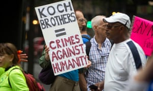 A protester holds up a sign against the Koch Brothers at the 'People's Climate March' in Manhattan in September 2014.