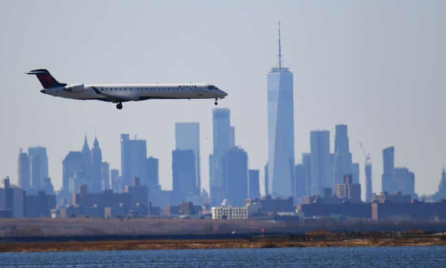 A Delta plane heads to land at JFK airport on 15 March 2020 in New York City.