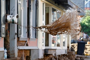 Bad Münstereifel, Germany. A soldier throws water out of a flooded house following heavy rainfall in North Rhine-Westphalia state