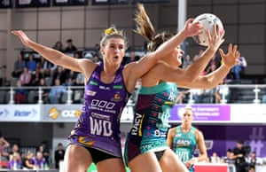 Gabi Simpson of the Firebirds and Liz Watson of the Vixens compete for the ball during the Super Netball round 8 match between the Firebirds and the Vixens at Brisbane Arena.