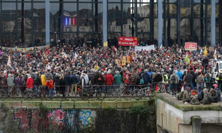 Demonstrators hold banners to protest against the expulsion of the families and farmers from land that would permit the construction of a new airport in Notre-Dame-des-Landes, outside the courthouse in Nantes, France, 13 January 2016.