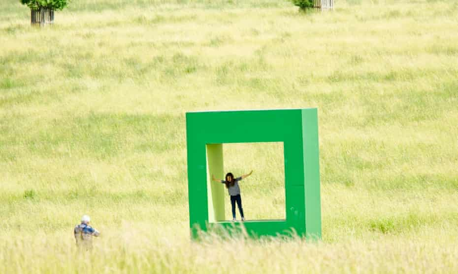 Child plays in, and is photographed at, an artwork at Compton Verney art gallery and park, Warwickshire.