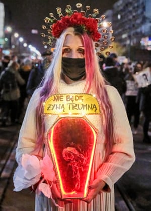 Young Polish woman in pro-choice fancy dress at protest in Warsaw.