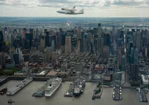 The space shuttle, Enterprise, mounted on a Nasa 747 Shuttle Carrier Aircraft on 27 April 2012, over New York.