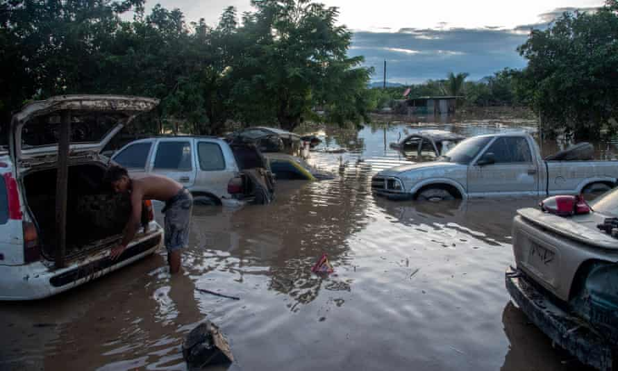 Flooded cars along a highway in San Pedro Sula, Honduras, days after Hurricane Eta hit the region.