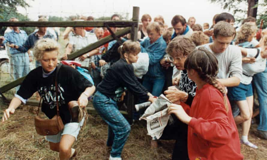 East German refugees flee through a gate near Sopron in Hungary in August 1989