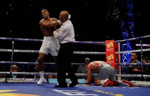 Sending Klitschko to the canvas one again, Klitschko rises, but goes down a second time, beats the count but Joshua comes in for the finish, Klitschko buckling under a flurry of punches and the referee intervenes! It's over!
