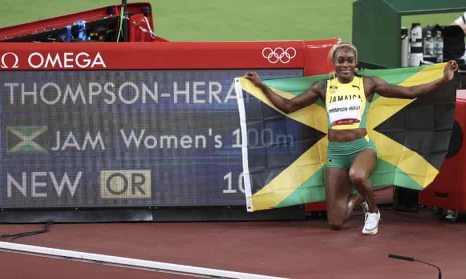 Jamaica's Elaine Thompson-Herah celebrates after winning the women's 100m athletics final.
