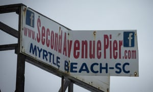High winds begin to dismantle a sign on the Second Avenue Pier as Hurricane Florence makes landfall on September 14, 2018 in Myrtle Beach, South Carolina.
