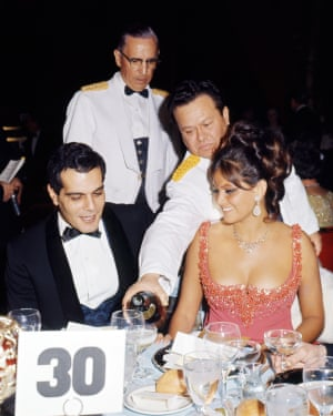 Dining with Italian actress Claudia Cardinale at the Golden Globe Awards, Los Angeles, 1966