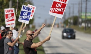 UAW workers strike outside the GM facility in Parma, Ohio. 'The corporation is making a lot of money and they need to invest some of it back into us.'