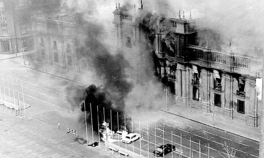 Coup … Smoke pours from the Chilean presidential palace after being hit by rockets launched from Hawker Hunters.