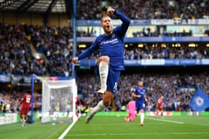 Chelsea's Eden Hazard jumps in the air as he celebrates scoring the opening goal during the 1-1 draw with Liverpool at Stamford Bridge.