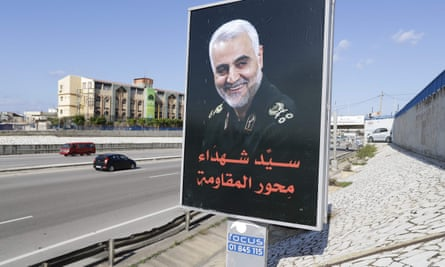 A portrait of the assassinated Iranian military commander Qassem Suleimani is pictured on the main road leading to the airport in the Lebanese capital Beirut on 11 January 2020.