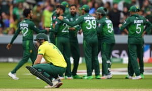 South Africa's David Miller ponders defeat as Pakistan players celebrate another wicket.