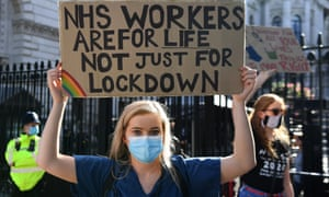 NHS workers are seen during a demonstration in London on 29 July.