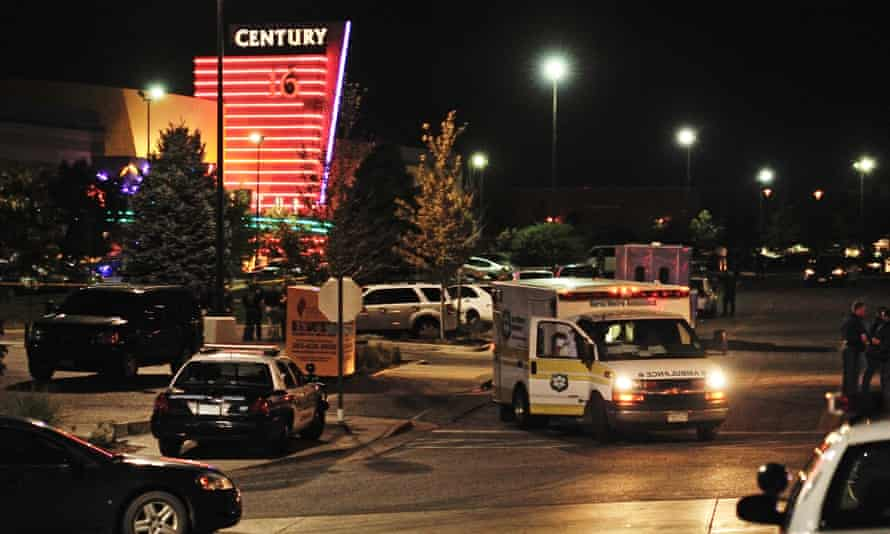 An ambulance is parked outside the Century 16 Theater in the Town Center mall in Aurora, Colorado.